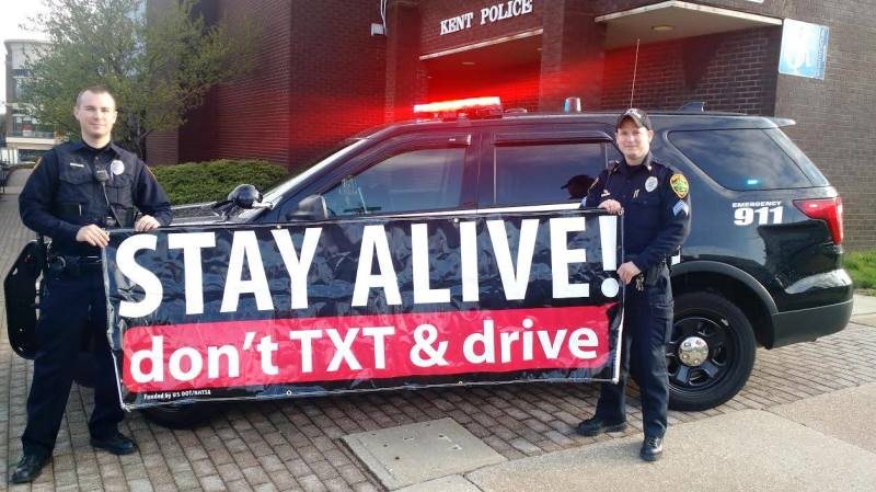 Patrol Officers Holding Stay Alive! Banner