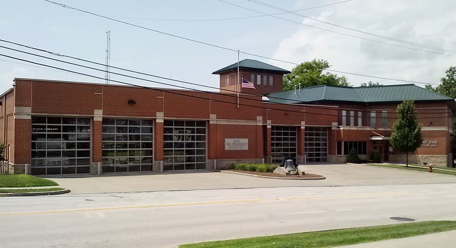 Ladder fire truck with doors opened inside garage at kent fire station