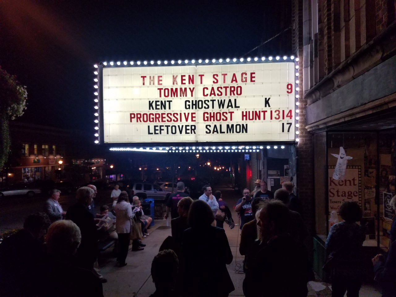 people gathered outside the kent stage at night