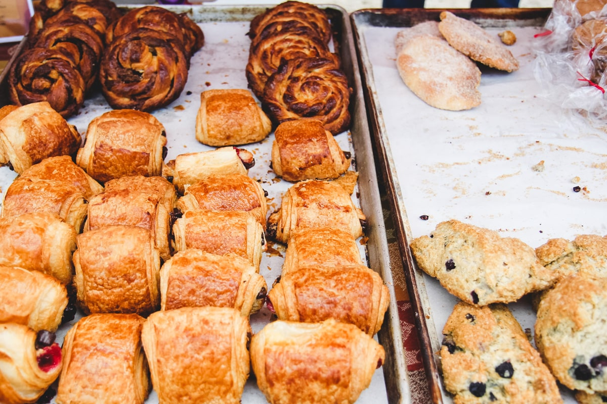 baking sheet with four rows of pastries, croissant, scones